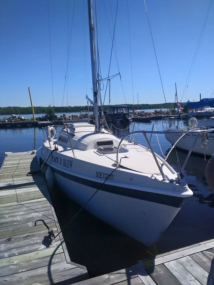 Tanzer 26 moored at dock without sails hoisted