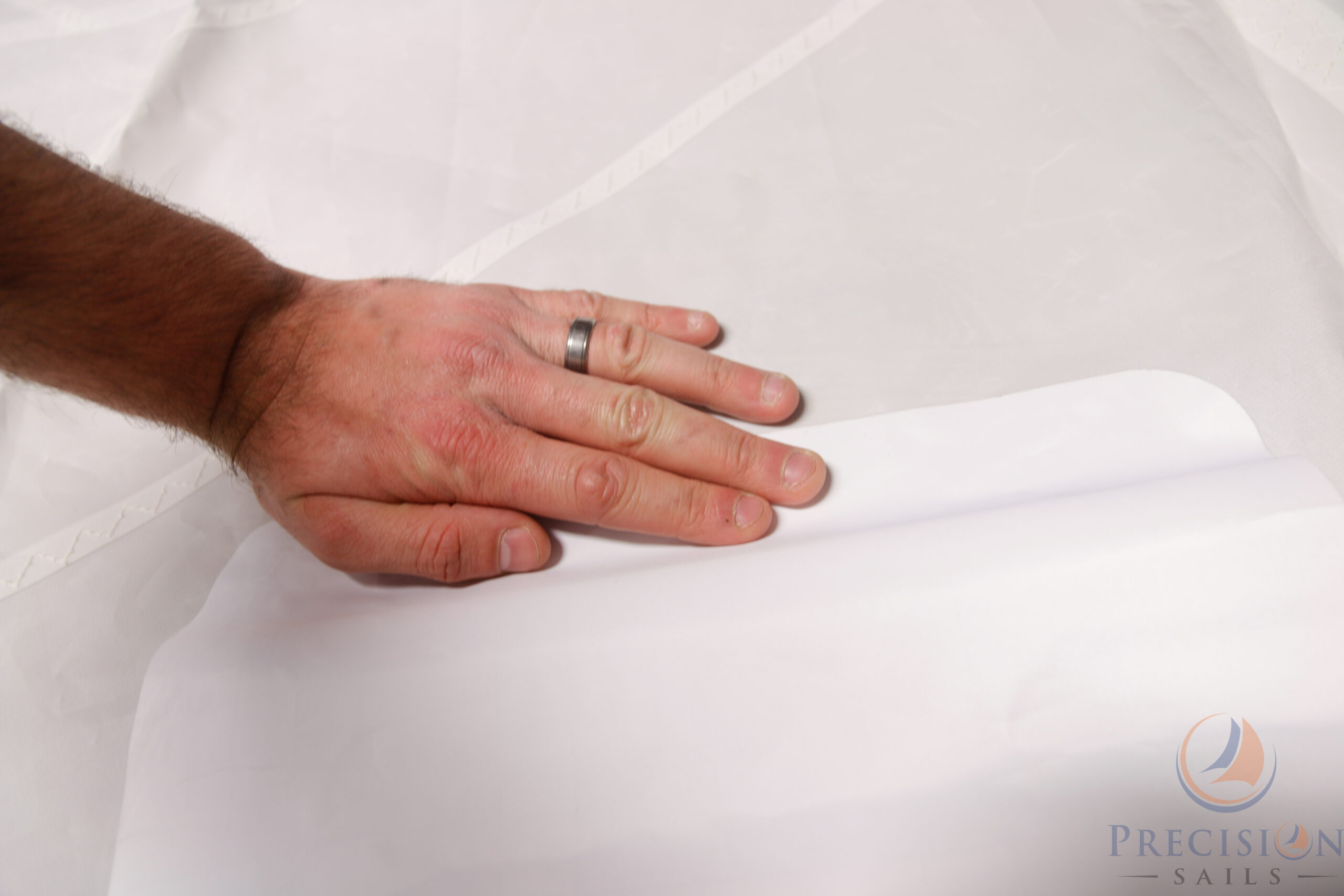 Apply Spreader Patch to Edge of Sail