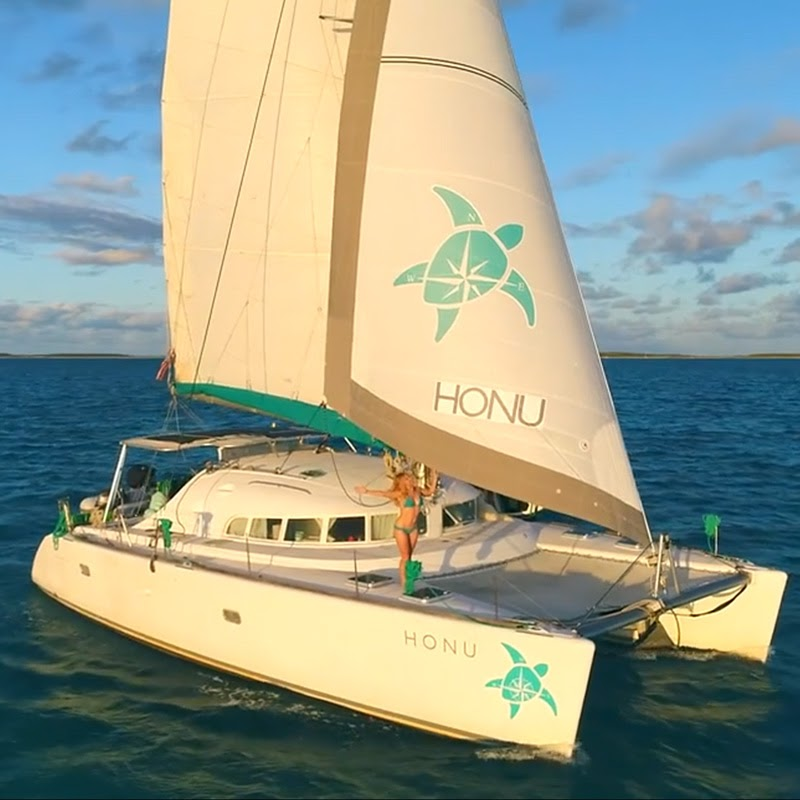 Lagoon 410 Custom Graphic Headsail with pretty lady aboard